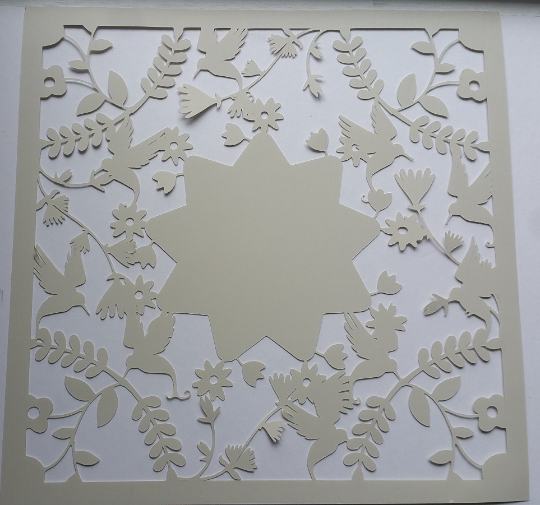 Paper Cutout of birds and flowers